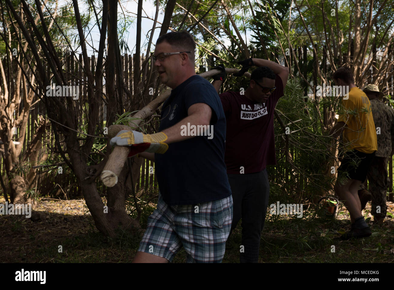 HONOLULU -- (April 13, 2018) Hawaii-area Sailors and families participated in the second in a series of planned cleanups working in conjunction with State of Hawaii along Nimitz Highway in Honolulu, April 13. The goal of the cleanup is to improve the conditions of the neighborhood. (Photo by Mass Communication Specialist 1st Class Corwin M. Colbert) - Stock Image
