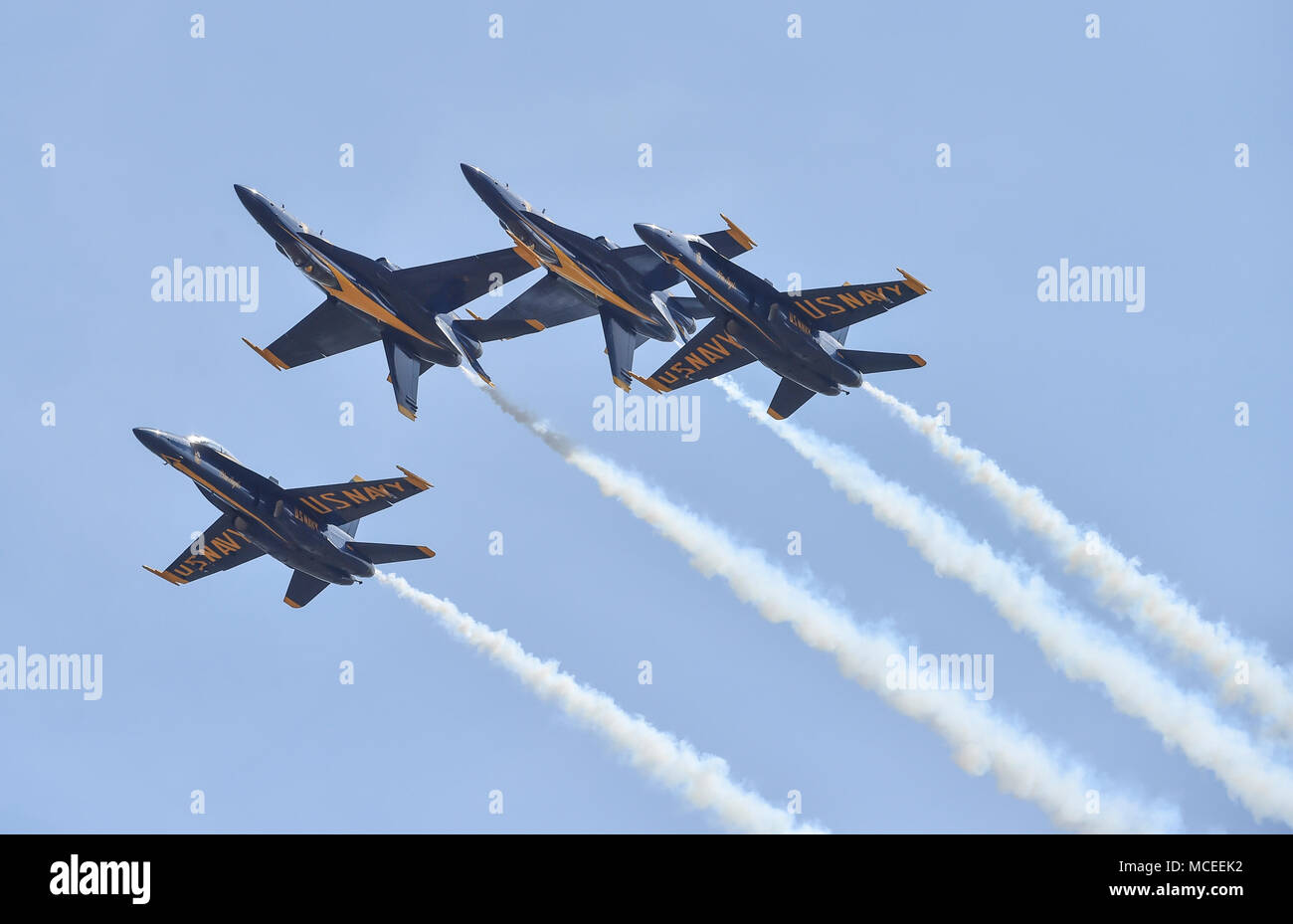 180412-N-NI474-2205  TUSCALOOSA, Ala. (April 12, 2018) The U.S. Navy flight demonstration squadron, the Blue Angels, Diamond pilots perform the Double Farvel maneuver during a practice demonstration for the Tuscaloosa Regional Air Show. The Blue Angels are scheduled to perform more than 60 demonstrations at more than 30 locations across the U.S. and Canada in 2018. (U.S. Navy photo by Mass Communication Specialist 1st Class Daniel M. Young/Released) - Stock Image