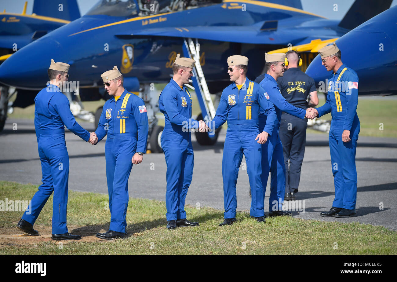 180412-N-NI474-3211  TUSCALOOSA, Ala. (April 12, 2018) The U.S. Navy flight demonstration squadron, the Blue Angels, Delta pilots shake hands after performing a practice demonstration for the Tuscaloosa Regional Air Show. The Blue Angels are scheduled to perform more than 60 demonstrations at more than 30 locations across the U.S. and Canada in 2018. (U.S. Navy photo by Mass Communication Specialist 1st Class Daniel M. Young/Released) - Stock Image