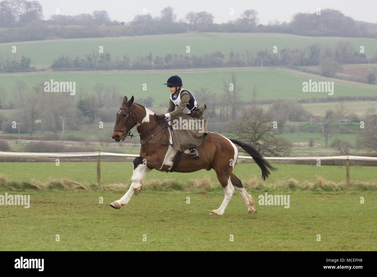 sidesaddle chase in the English countryside - Stock Image