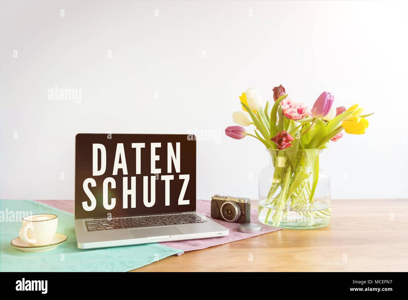 German word datenschutz written on laptop screen meaning data german word datenschutz written on laptop screen meaning data privacy in english on wooden office desk with flowers in front of white background malvernweather Gallery