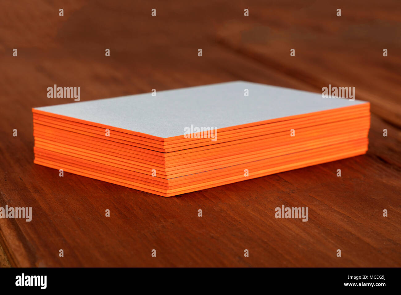 A stack of blank layered business cards with painted edges, on a ...
