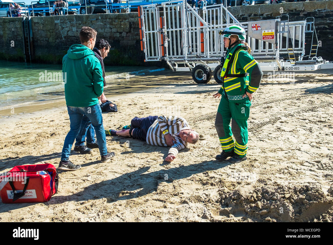 Volunteers and health professionals participating in a GMICE (Good Medicine in Challenging Environments) major incident exercise in Newquay Harbour in - Stock Image