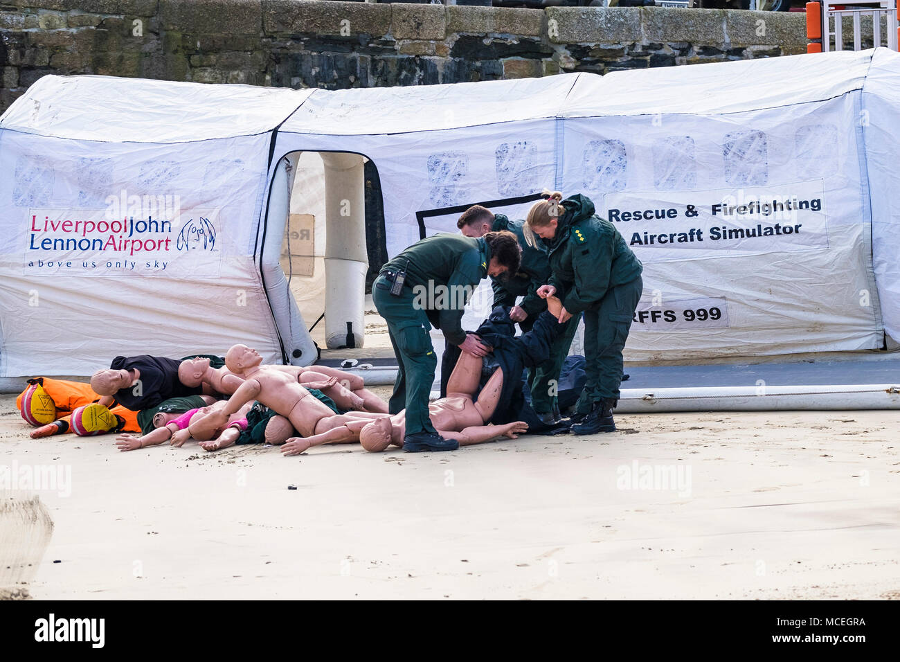 Paramedics putting clothes on mannequins in preparation for participating in a GMICE (Good Medicine in Challenging Environments) major incident exerci - Stock Image