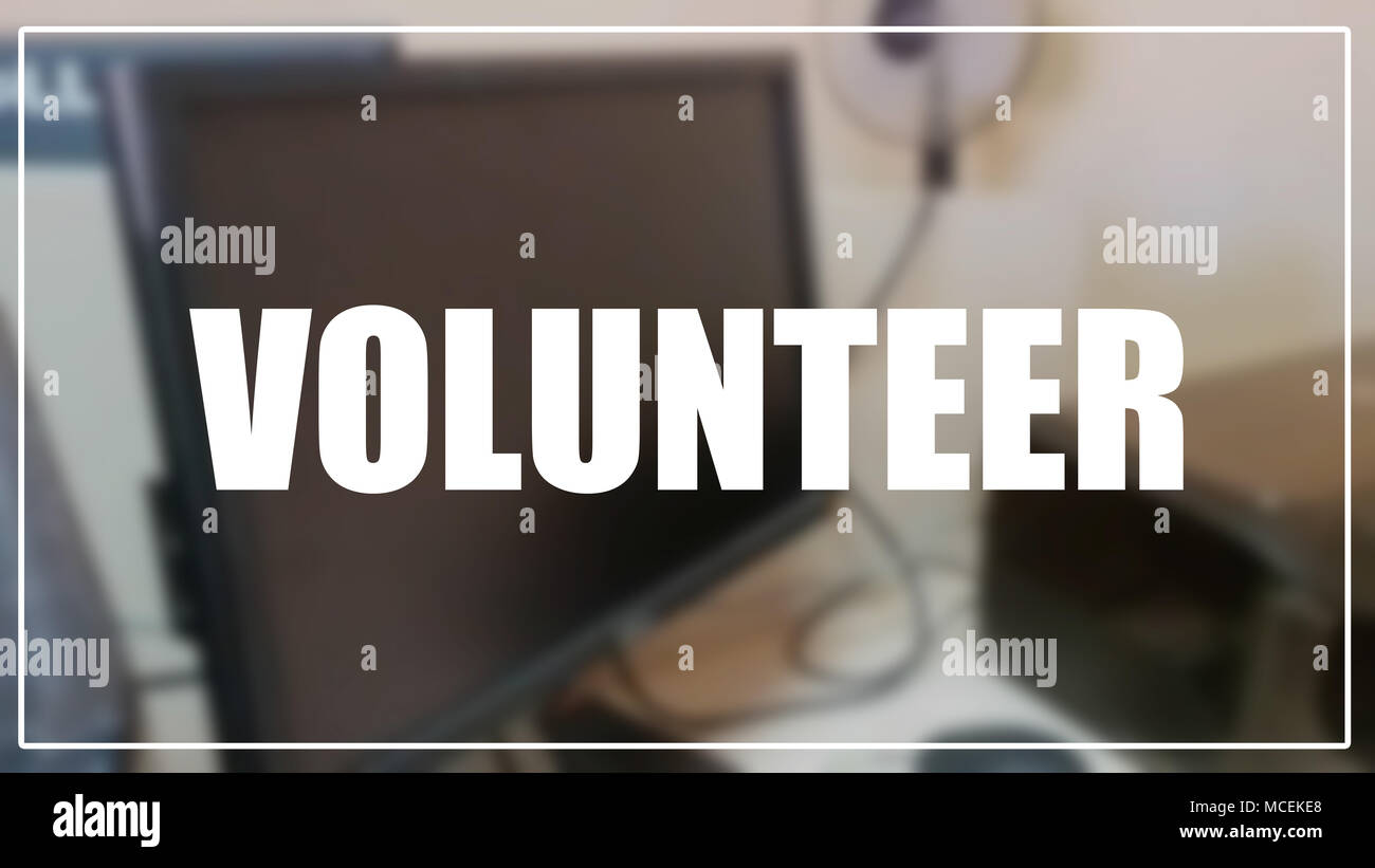 Volunteer word with blurring business background - Stock Image