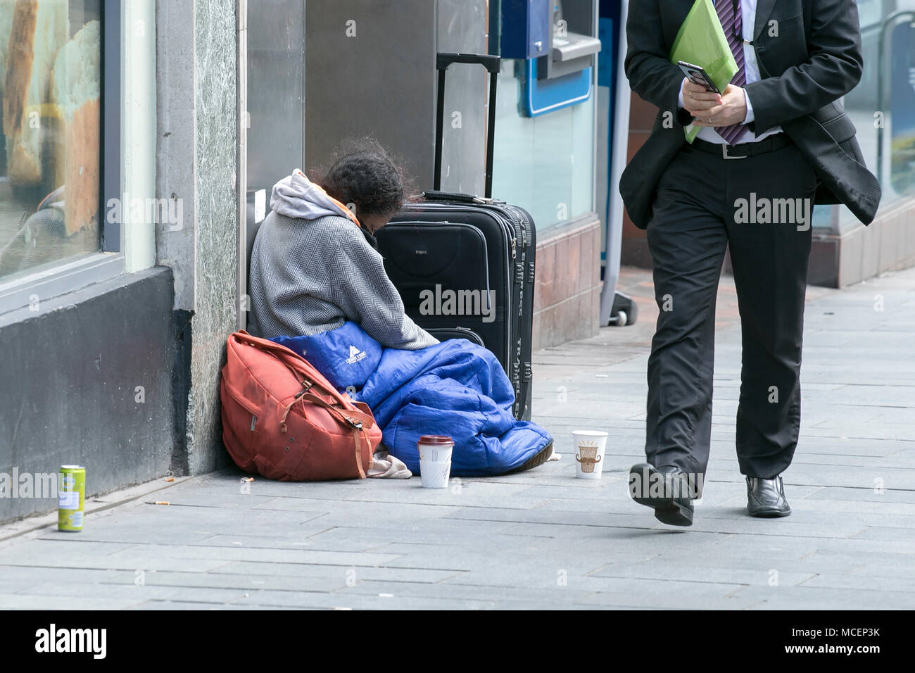 homeless homelessness beg beggar tramp swep rough sleeper sleeping cold street poor hungry person bag lone alone begging suffer sadness - Stock Image