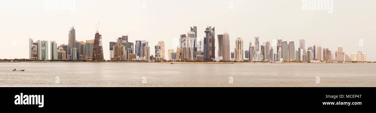 DOHA, QATAR - April 16, 2018: Panoramic view of Doha's towers against an overcast sky. High resolution stitched file - Stock Image