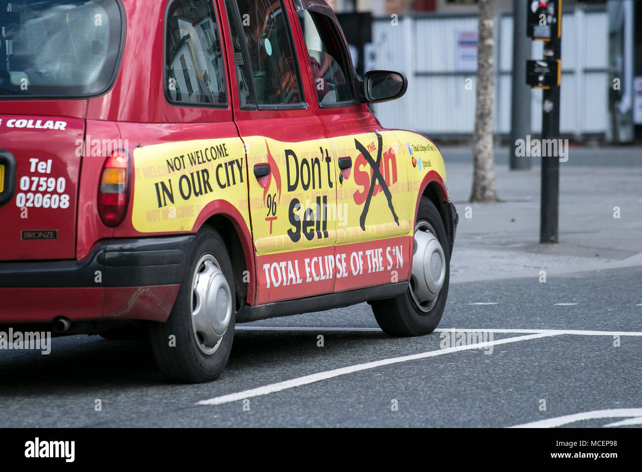 Do not buy The Sun newspaper on side of taxi in Liverpool city centre - Stock Image