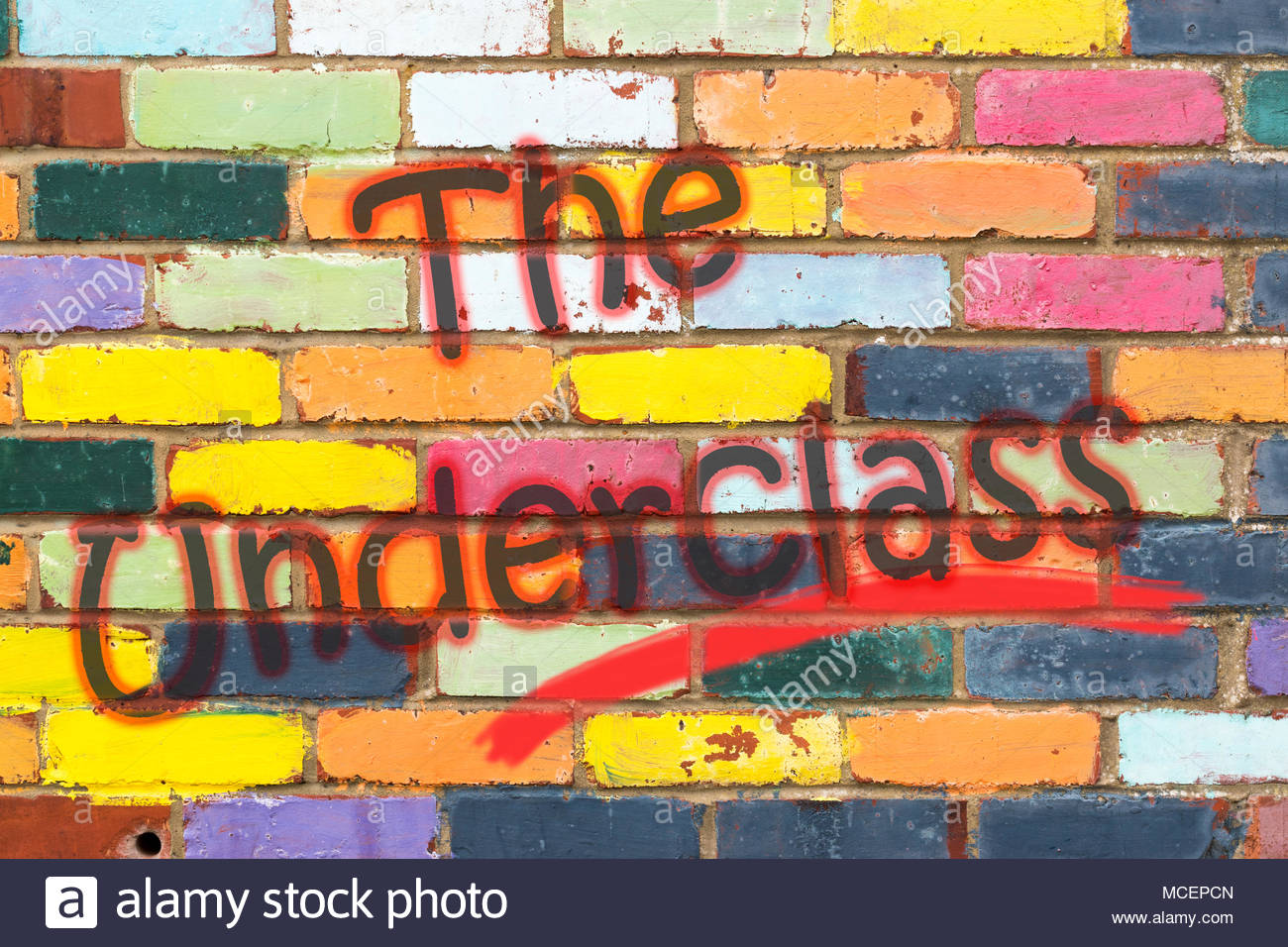 Looking at a very colourful brickwall with the wording The Underclass. Dorset, England - Stock Image
