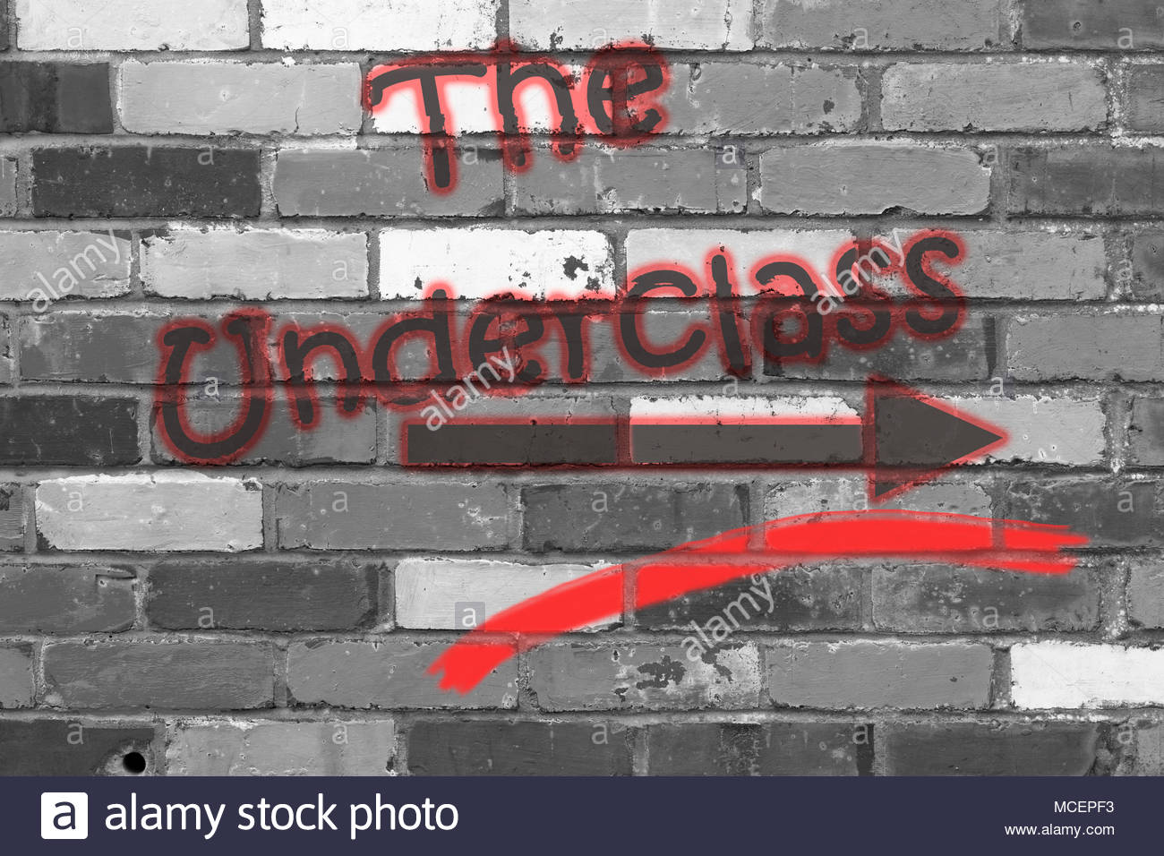 Looking at a black and white brickwall with the wording The Underclass with arrow. Dorset, England - Stock Image