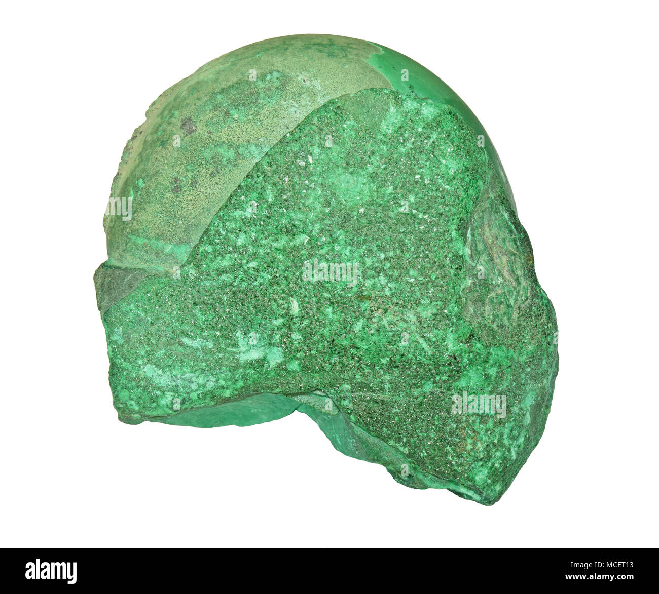 Raw specimen of a malachite stone on white background - Stock Image