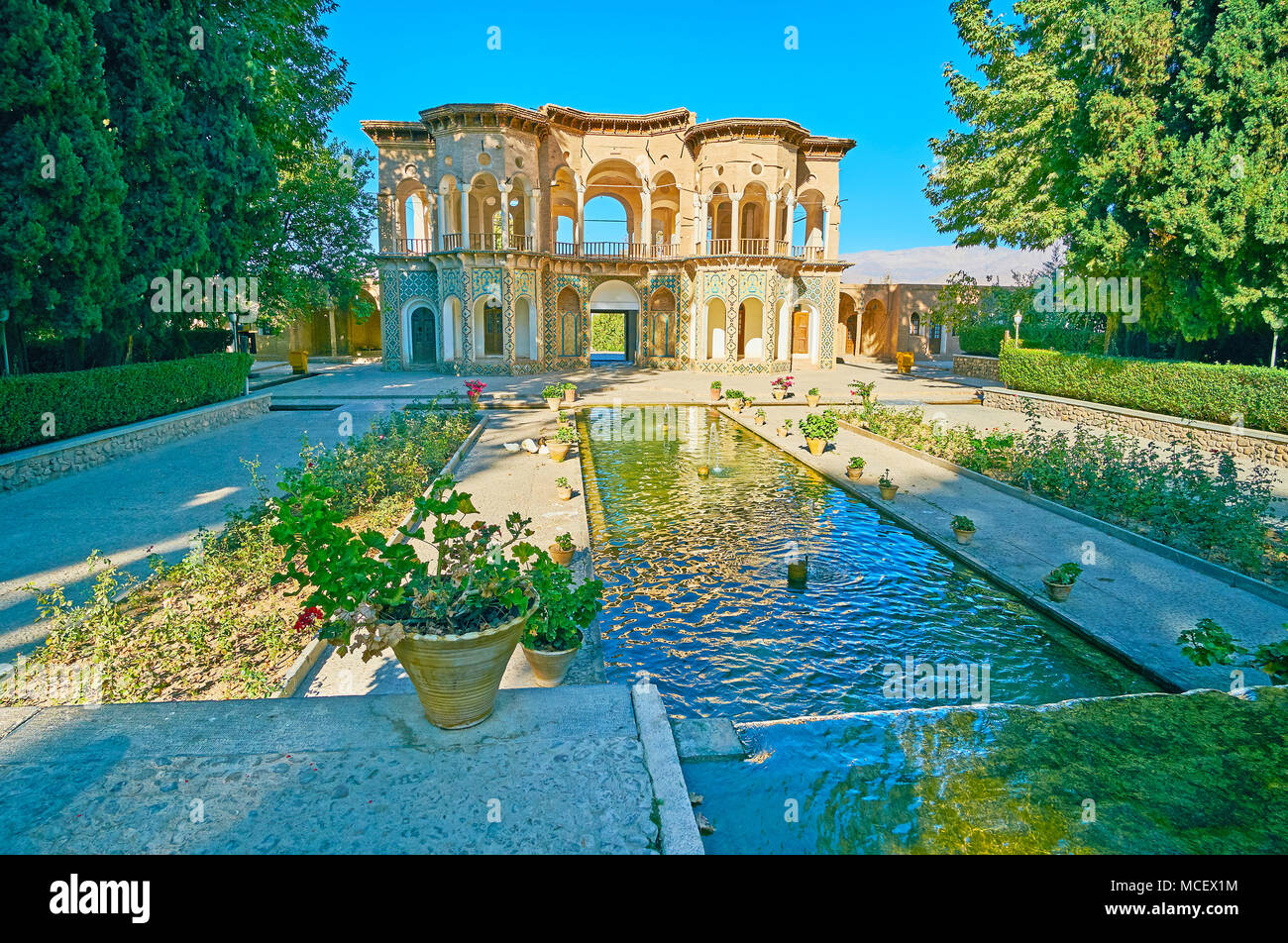 Shady historical Shazdeh Garden is the perfect place to relax and enjoy the cool microclimate, created in hot and dry desert of Kerman Province, Mahan - Stock Image