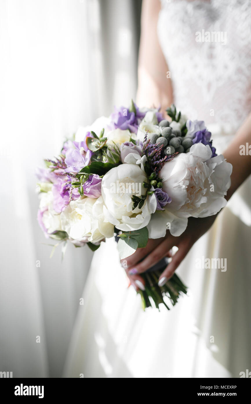 Brides Wedding Bouquet With Peonies Freesia And Other Flowers In Women S Hands Light And Lilac Spring Color Morning In Room Stock Photo Alamy