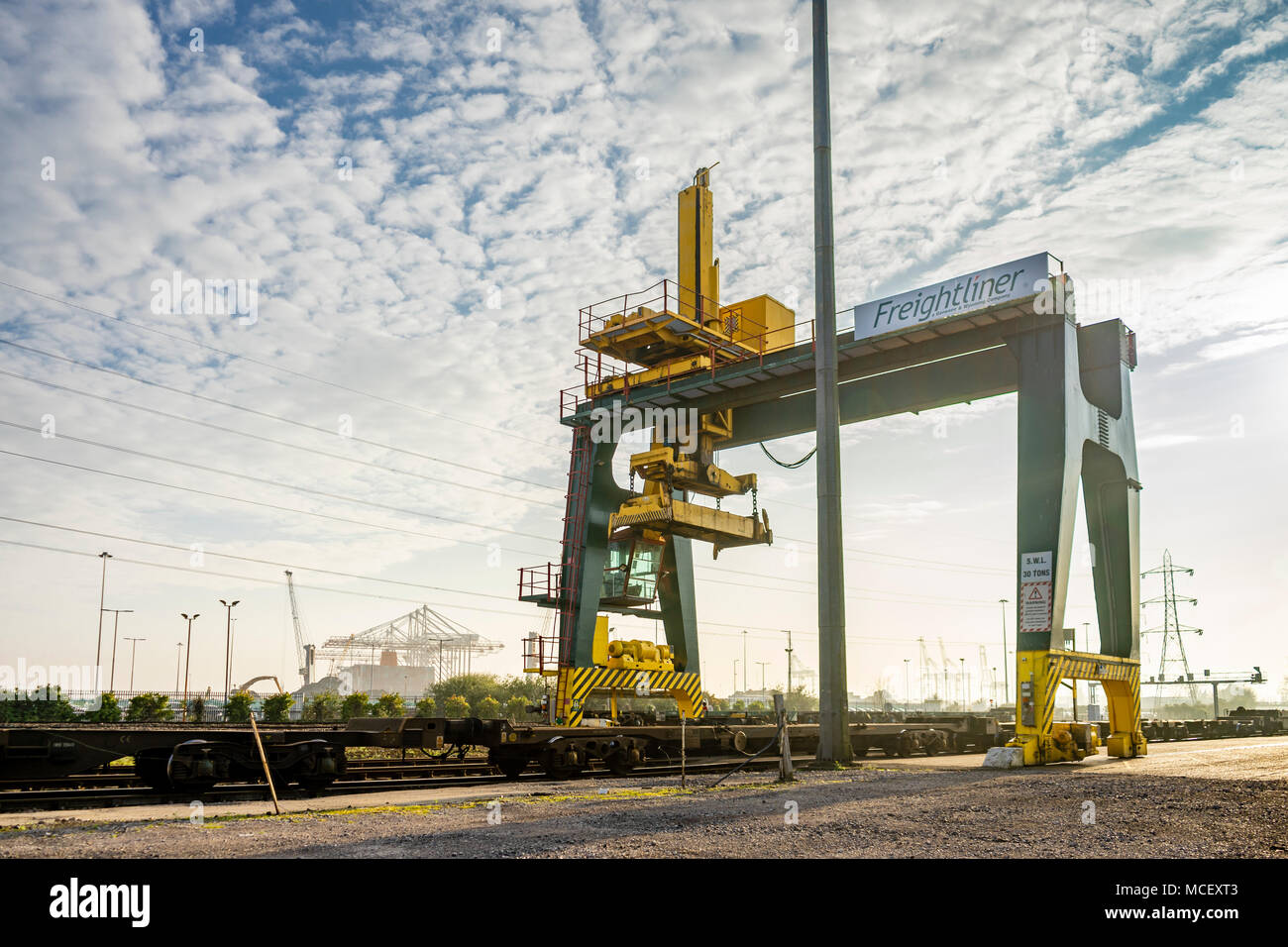 Rail mounted Freightliner crane with empty container crane in the Docks of Southampton, Port of Southampton, England, UK - Stock Image
