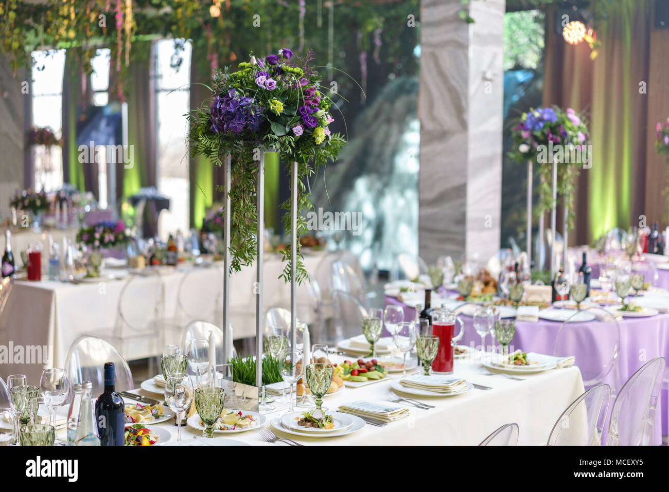 beautiful hydrangea bouquets in vases on high stands. Flower ...