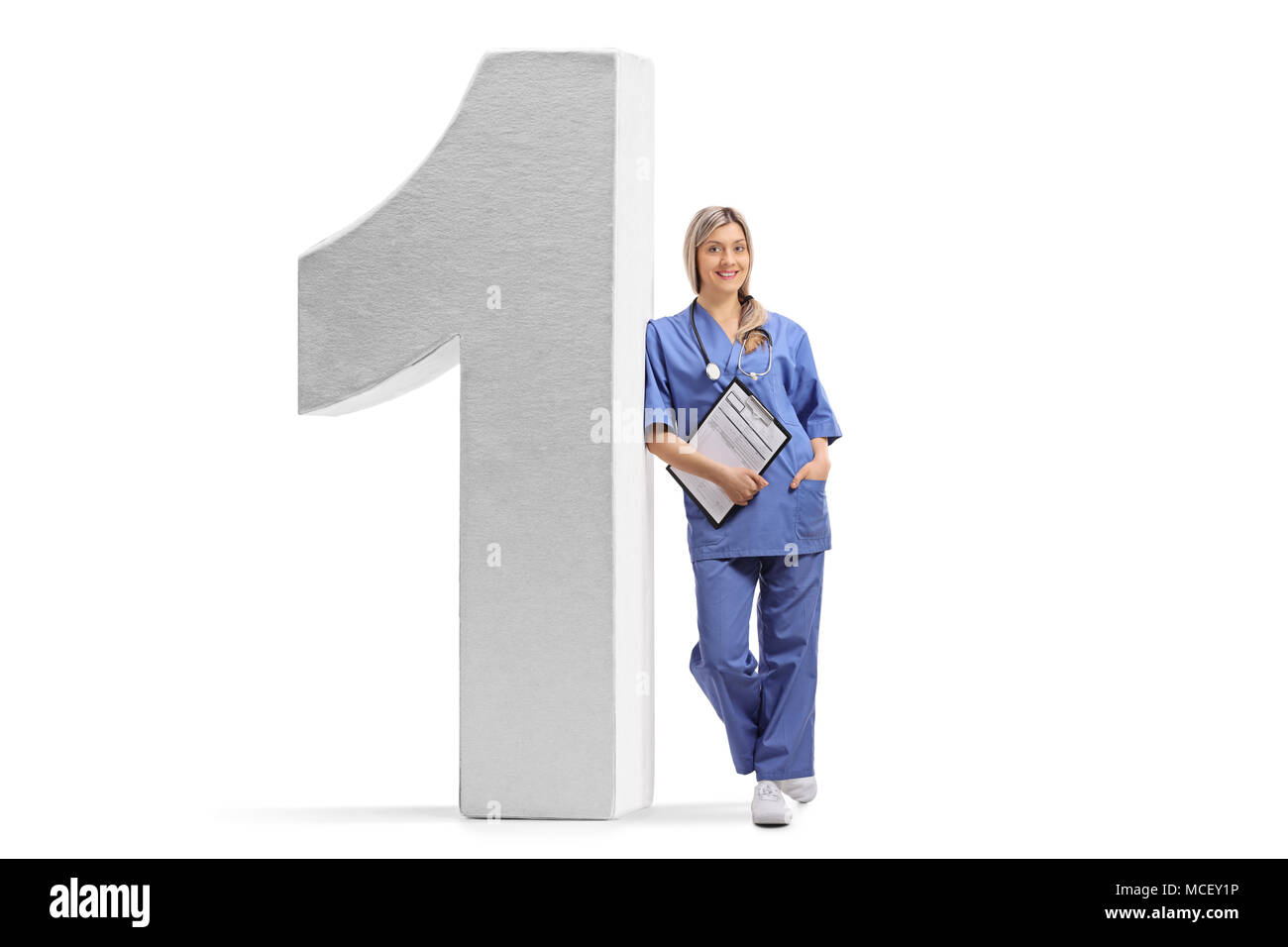 Full length portrait of a female doctor leaning against a number one figure isolated on white background Stock Photo