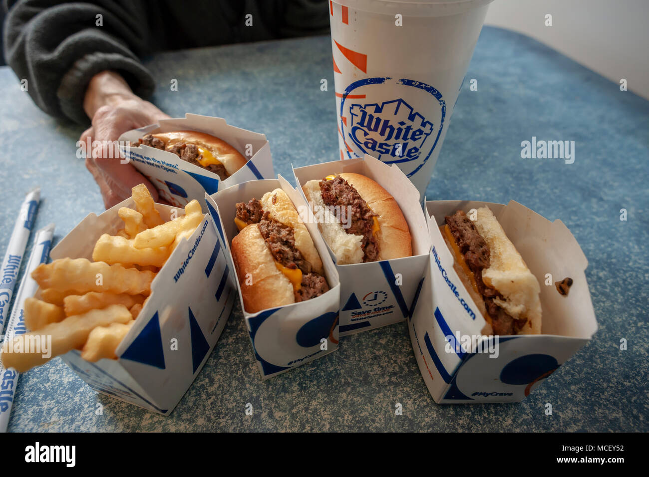 White Castle debuts the Impossible Slider using plant-based 'meat' from Impossible Foods, seen in a White Castle in Brooklyn in New York on Sunday, April 15, 2018. Impossible Foods meatless ground beef is being used to create the new menu item, previously only available in higher-end fast casual restaurants and is currently on the menu is 140 locations in the New York and Chicago areas.The sliders sell for $1.99, approximately double the price of their original product. (© Richard B. Levine) - Stock Image