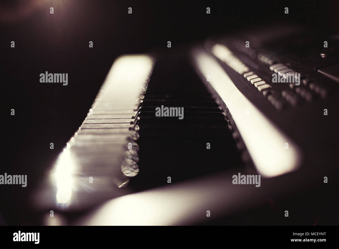 Synthesizer keyboard in the dark - Stock Image