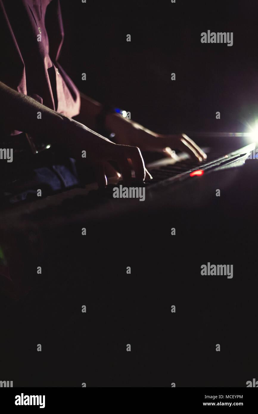 Playing on synthesizer keyboard - Stock Image