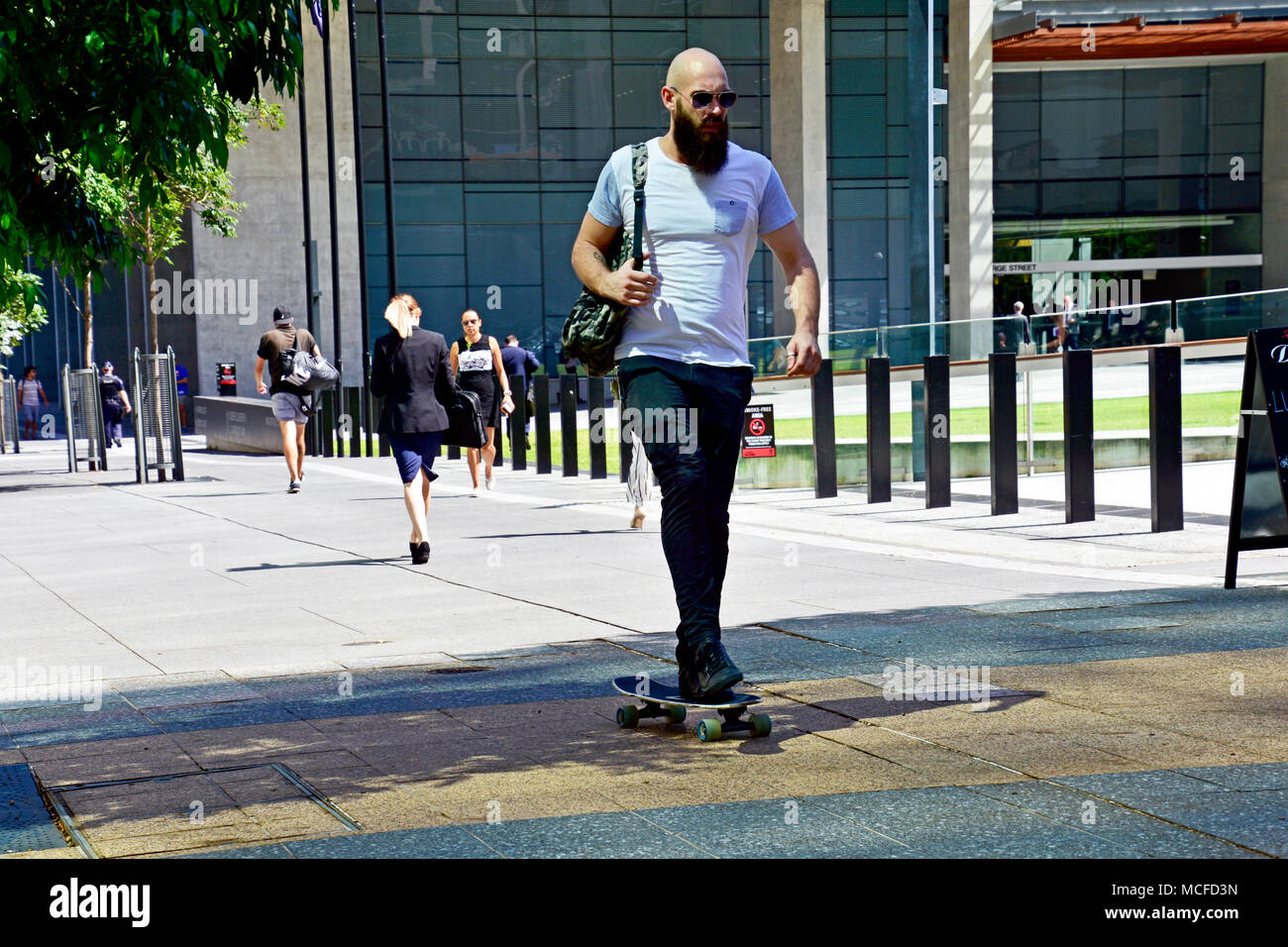 MAN ON A SKATE BOARD - Stock Image