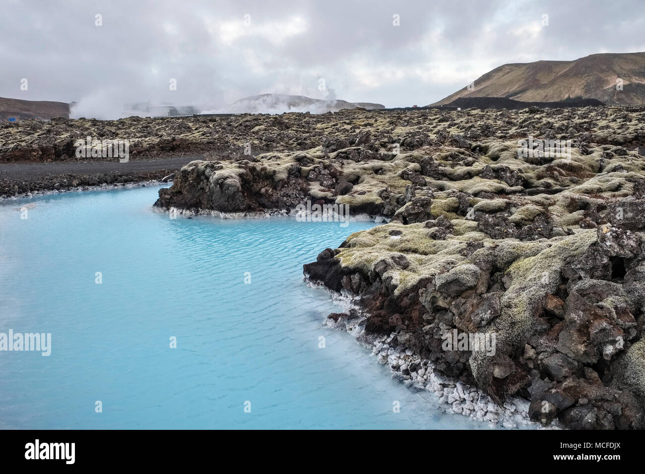 Grindavik, Reykjanes Peninsula, Iceland. Waste hot water from the Svartsengi geothermal power station, which also supplies the Blue Lagoon spa nearby - Stock Image