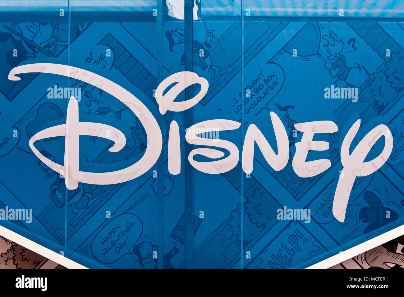Disney sign stock photos disney sign stock images alamy disney logo sign printed on banner the walt disney company commonly known as disney biocorpaavc Choice Image