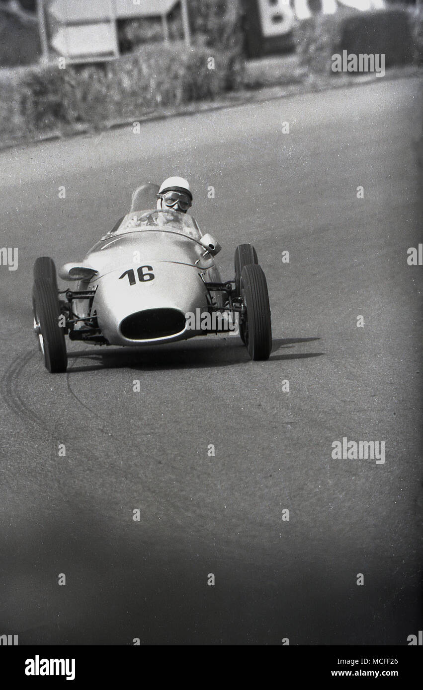 1960s, historical, a single seater, open-wheeled racing car being driven around a racetrack. - Stock Image
