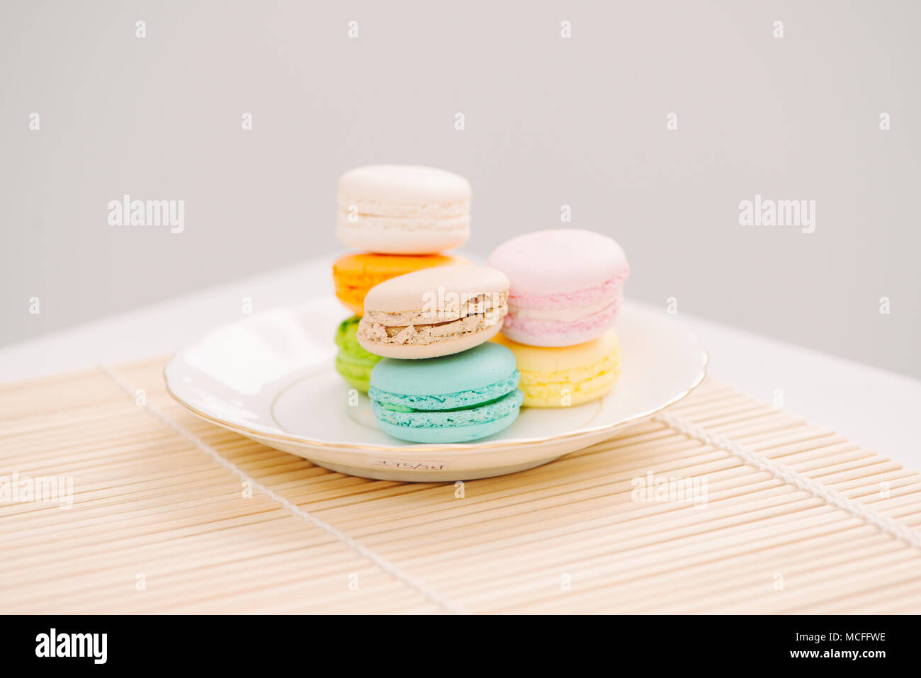 Delicious french dessert. Colorful pastel cake macaron or macaroon - Stock Image
