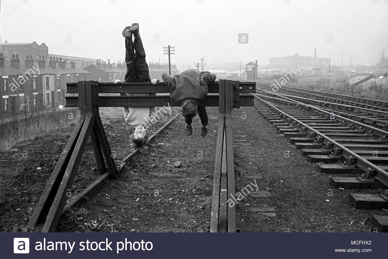 Two young boys playing on railway sidings in the 1970s, the photograph was taken near Waterloo Street, Bolton, Lancashire, North West, England, UK photo DON TONGE photographer - Stock Image