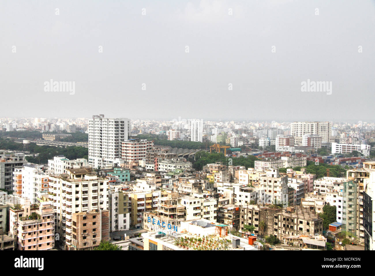 Dhaka, Bangladesh. A top views of southeast part of Dhaka city on April 5, 2018. Dhaka is the capital city of Bangladesh, is located in central Bangladesh along the Buriganga River.Dhaka is one of the most populated city and it has been ranked as the ninth most polluted city in the world.In 2016, the population is 18.237 million in the Greater Dhaka Area, while the city itself has a population estimated at about 8.5 million according to data. © Rehman Asad/Alamy Stock Photo - Stock Image