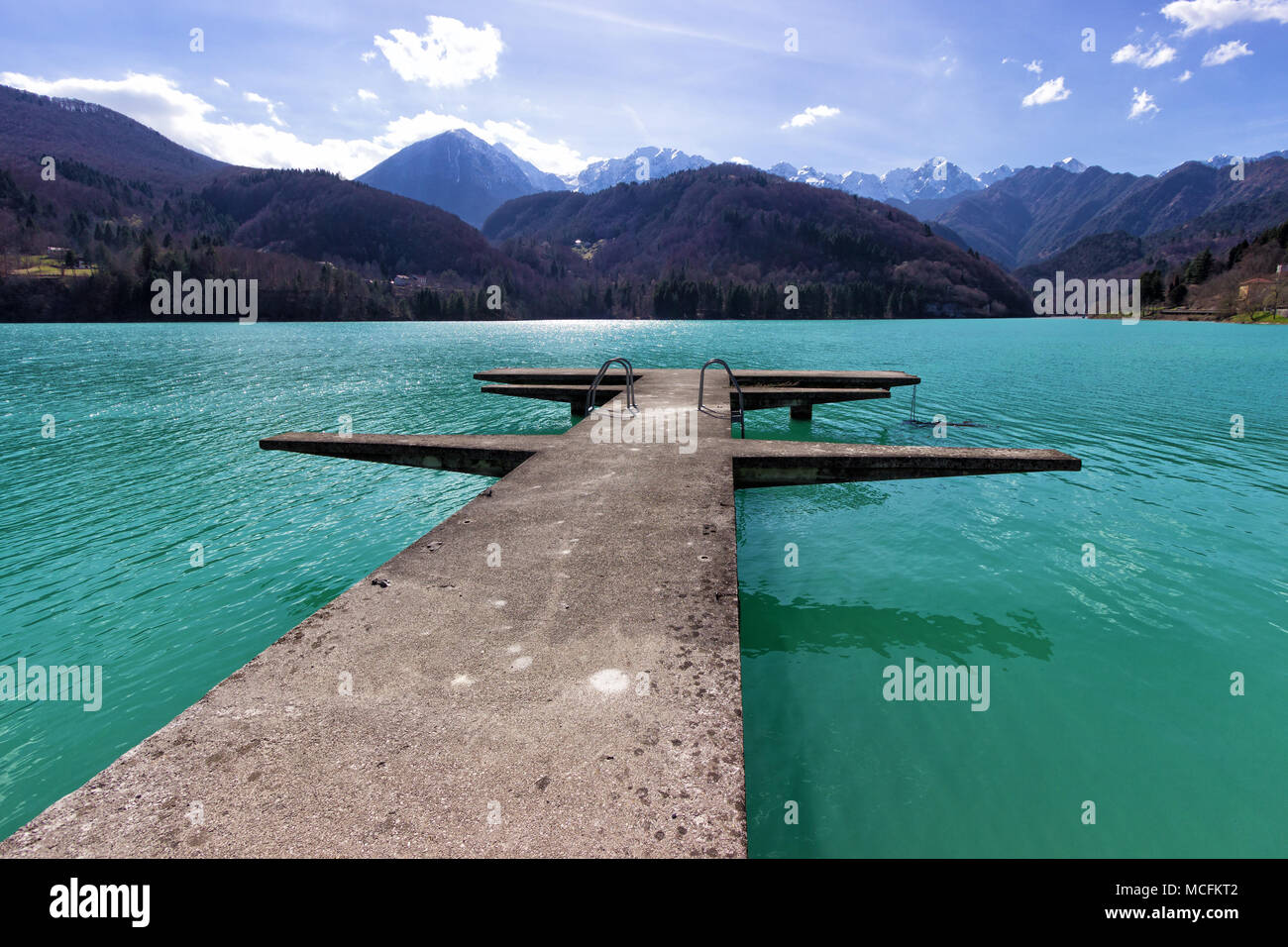 Italy, Valcellina. View of the Barcis lake's crystal water surrounded by mountains on the horizon Stock Photo