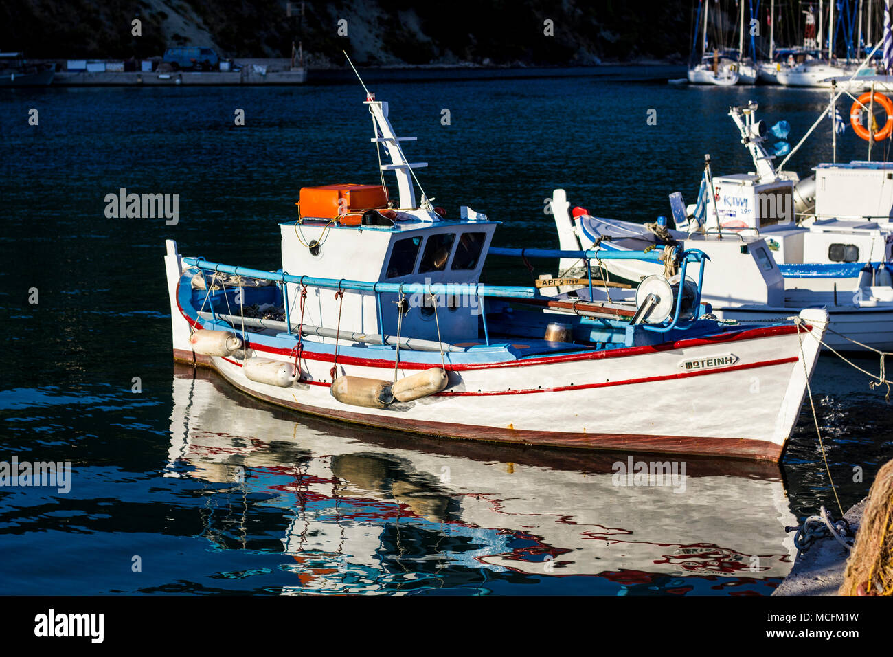 Small Fishing Boat tied up in Harbour - Stock Image