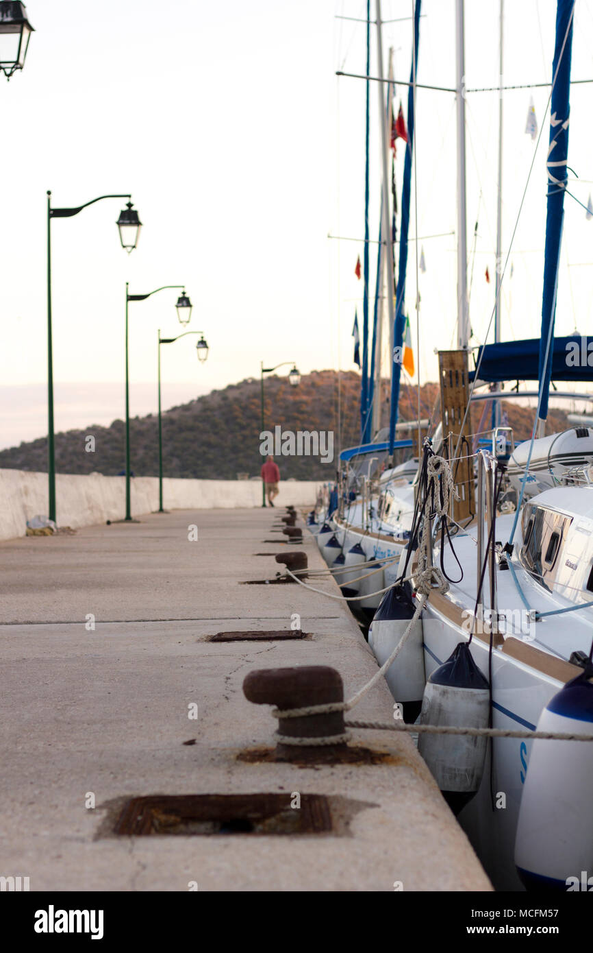 Sail boats tied to harbour - Stock Image