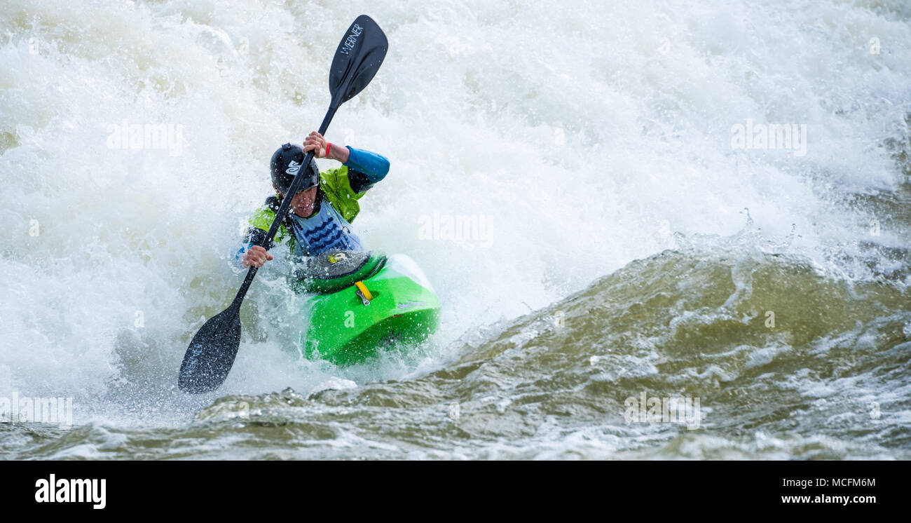 Skilled kayaker navigating a torrent of whitewater at Paddle South, the USA Freestyle Kayak National Championship in Columbus, GA. - Stock Image