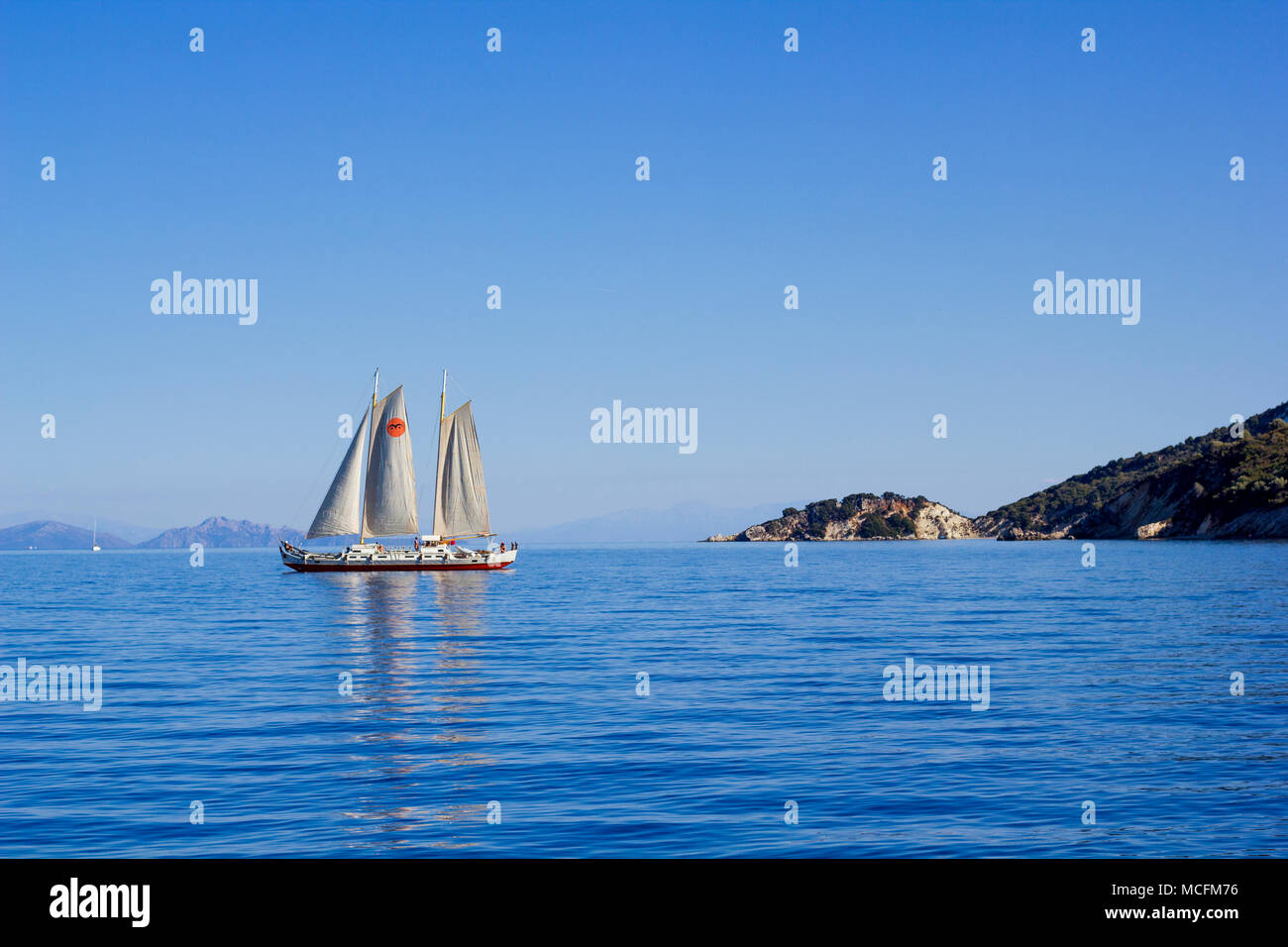 Long Sail Boat with sails up - Stock Image