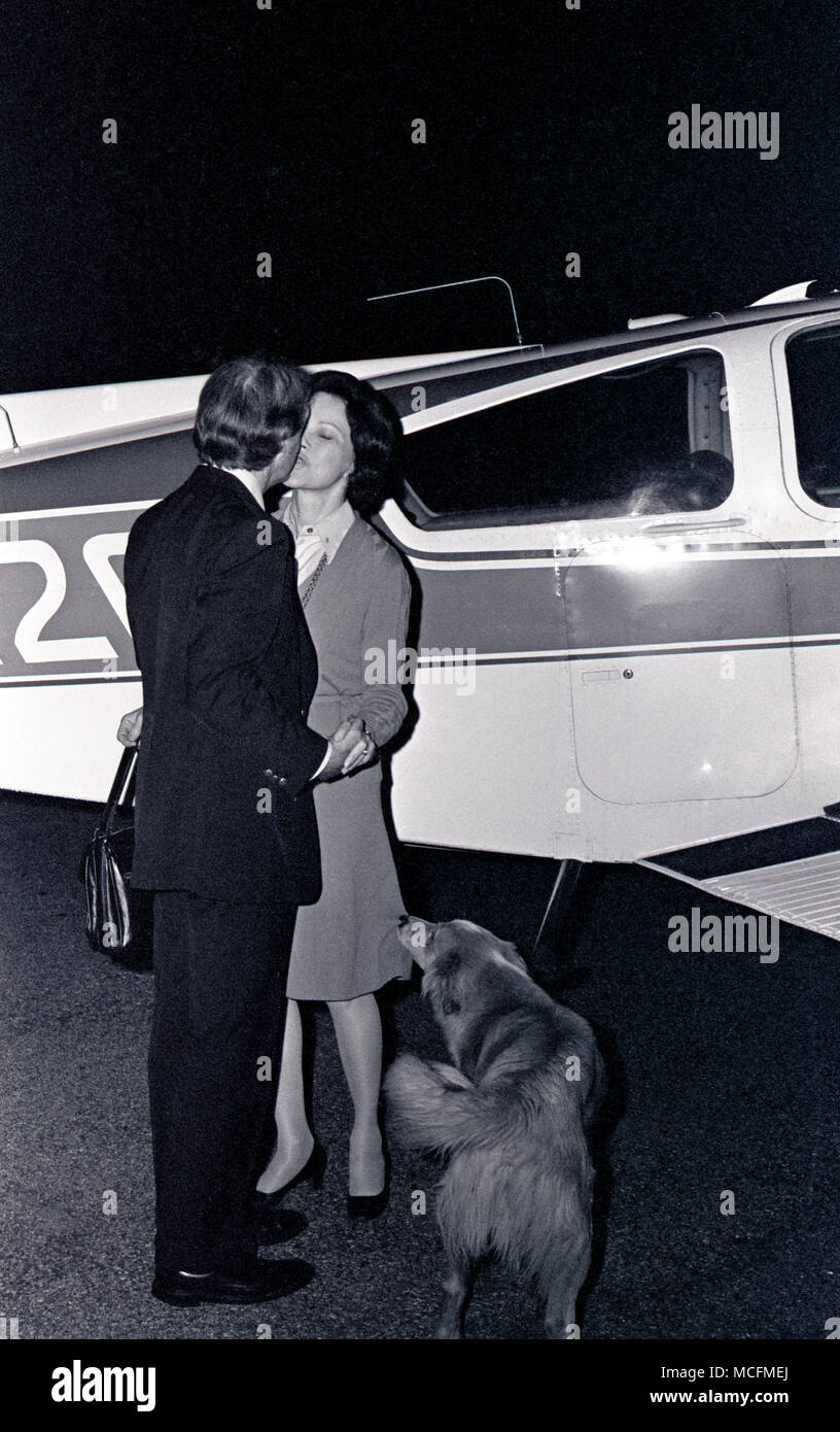 A hug and a greeting from the airport as Jimmy Carter meets Rosalynn's small plane at midnight after a day of campaigning. The couple would sometimes split up to canvass twice the territory during the primaries. Unlike today's candidates, the frugal Carter used a small aircraft early in his 1975–1976 presidential campaign. Stock Photo