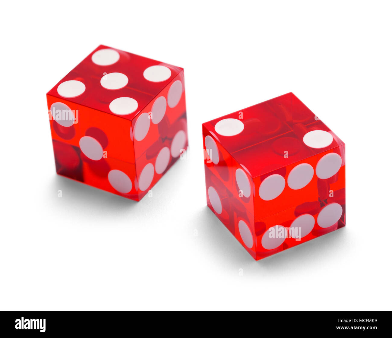Red Casino Gambling Dice Isolated on White Background. - Stock Image