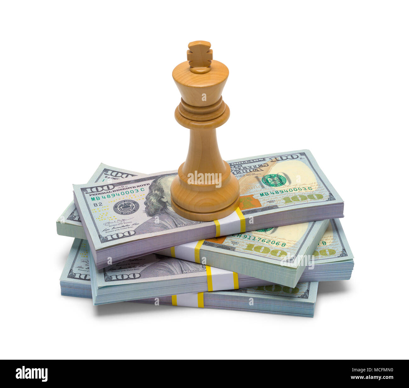 Pile of Money with a Chess King Isolated on a White Background. - Stock Image