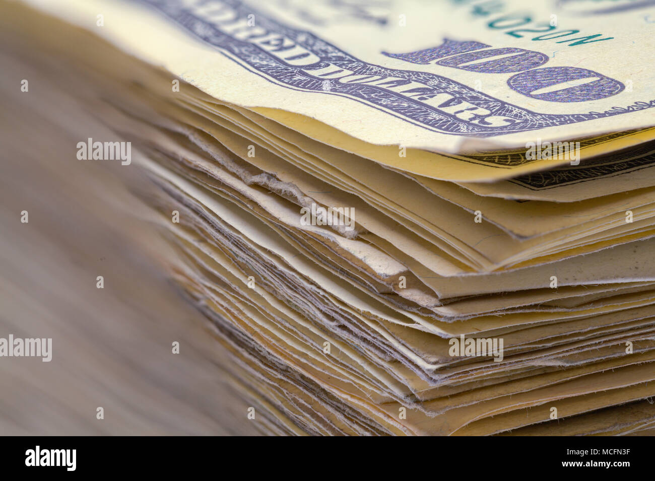 Close Up View of a Stack of Hundred Dollar Bills. - Stock Image