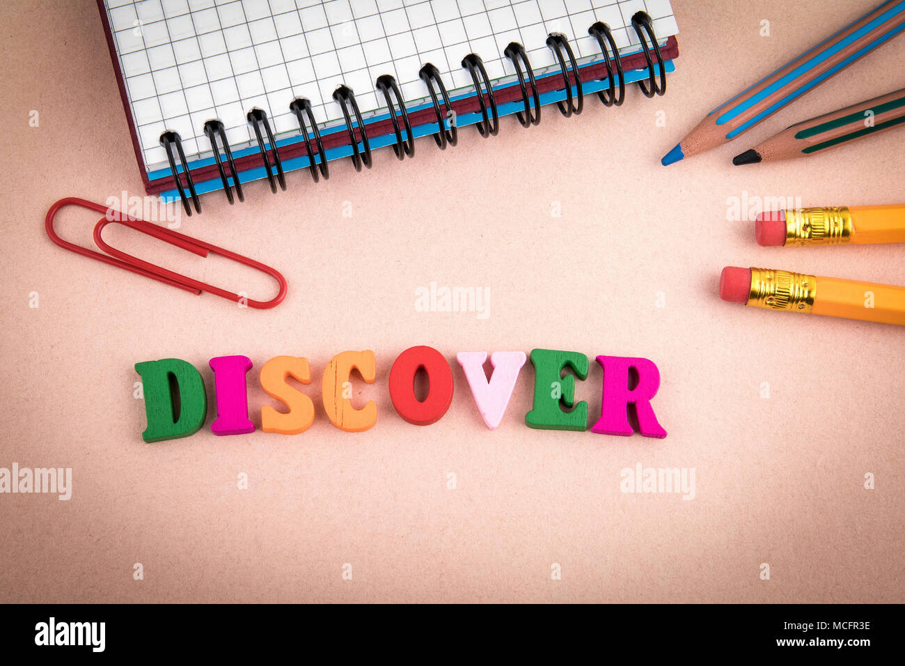 Discover. Wooden letters on the office desk - Stock Image