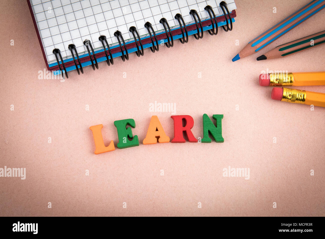 Learn. Wooden letters on the office desk - Stock Image