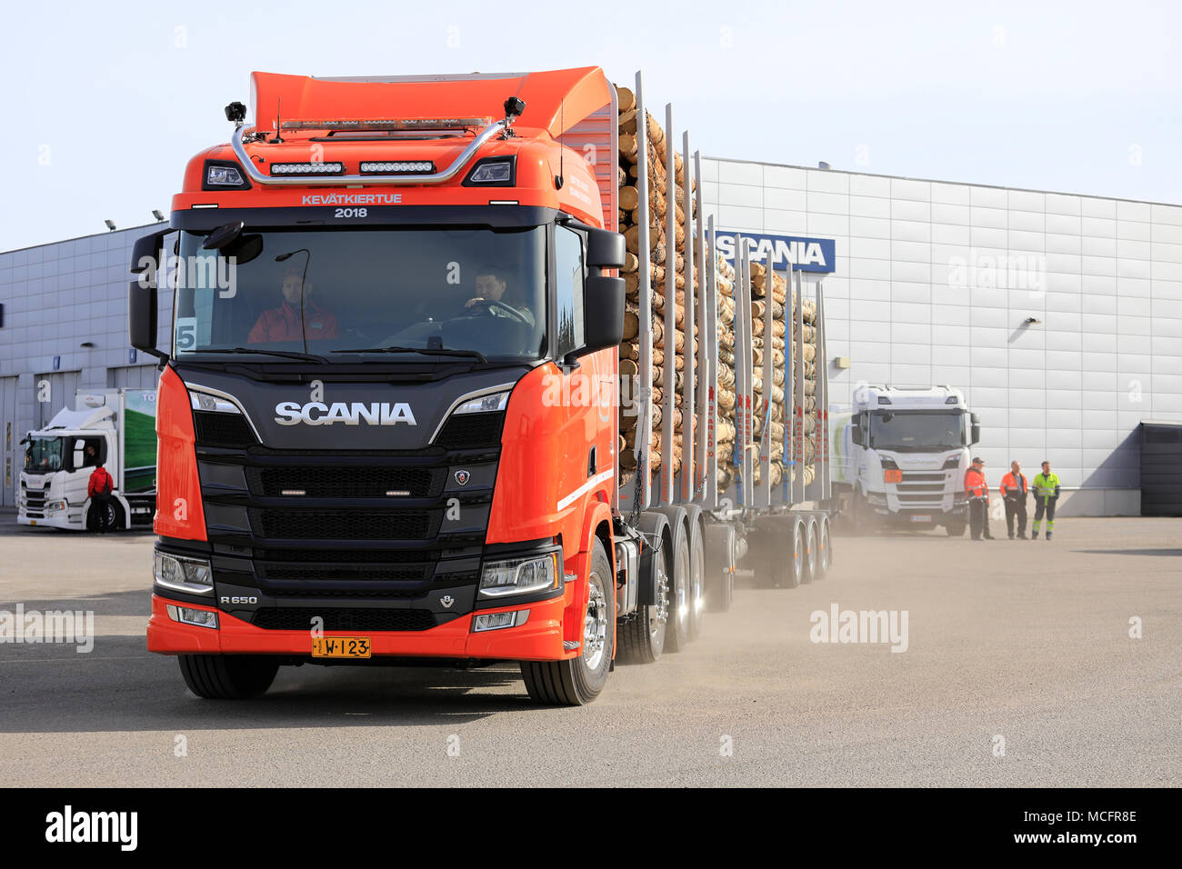LIETO, FINLAND - APRIL 12, 2018: Orange Scania R650 logging truck at Scania dealer for test drive during Scania Tour 2018 in Turku. - Stock Image