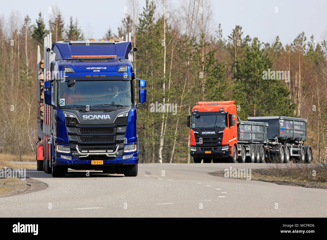 LIETO, FINLAND - APRIL 12, 2018: Blue Scania R730 logging truck and R650 XT gravel combination on test drive during Scania Tour 2018 in Turku. - Stock Image