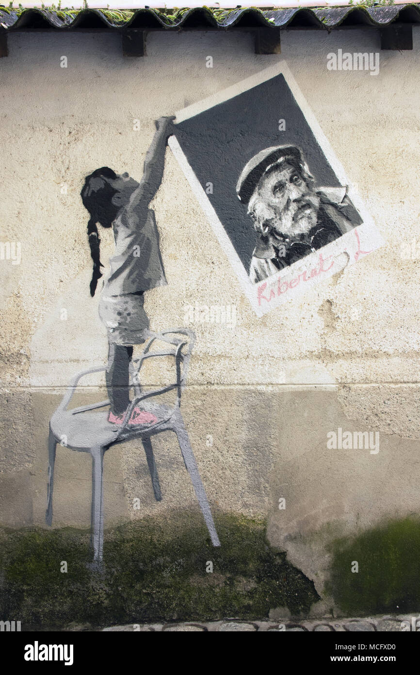 Painting on a wall of a narrow lane - photograph of Laurent Ribérat who visited and worked in Céret, Pyrénées-Orientales, Occitaine Region, France. - Stock Image