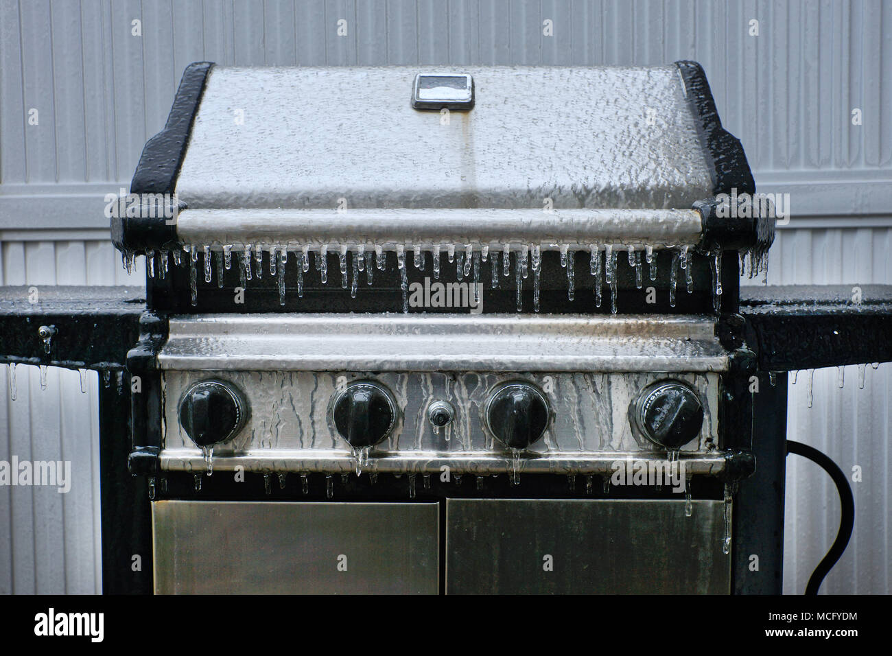 Montreal,Canada,16,April,2018.BBQ covered with ice and sleet. Credit:Mario Beauregard/Alamy Live News - Stock Image