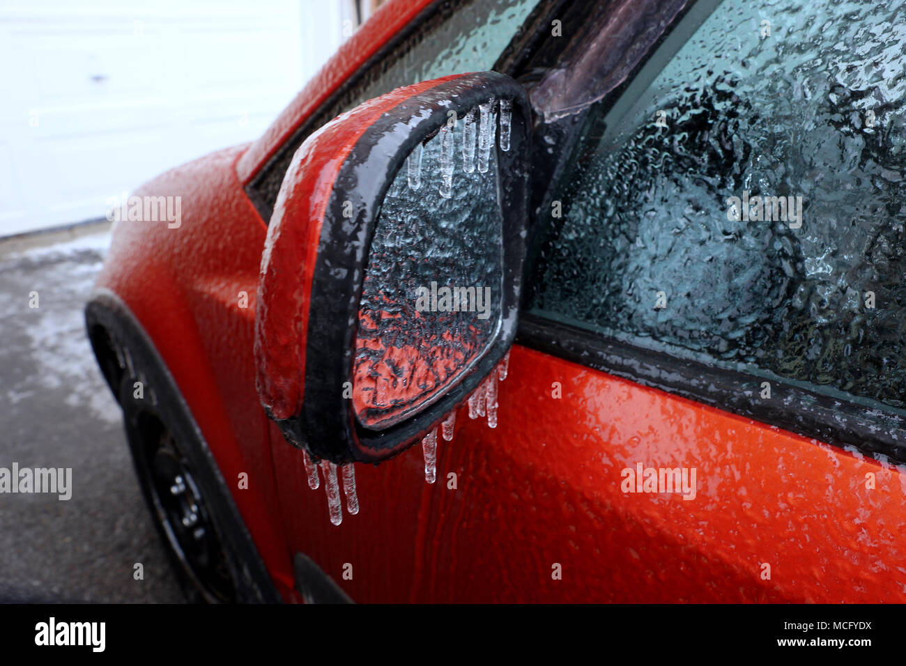 Montreal,Canada,16,April,2018.Car mirror covered with ice and sleet. Credit:Mario Beauregard/Alamy Live News - Stock Image
