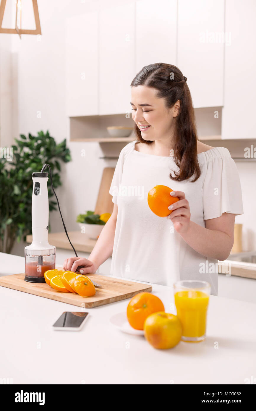 Appealing pleased woman keeping fit - Stock Image