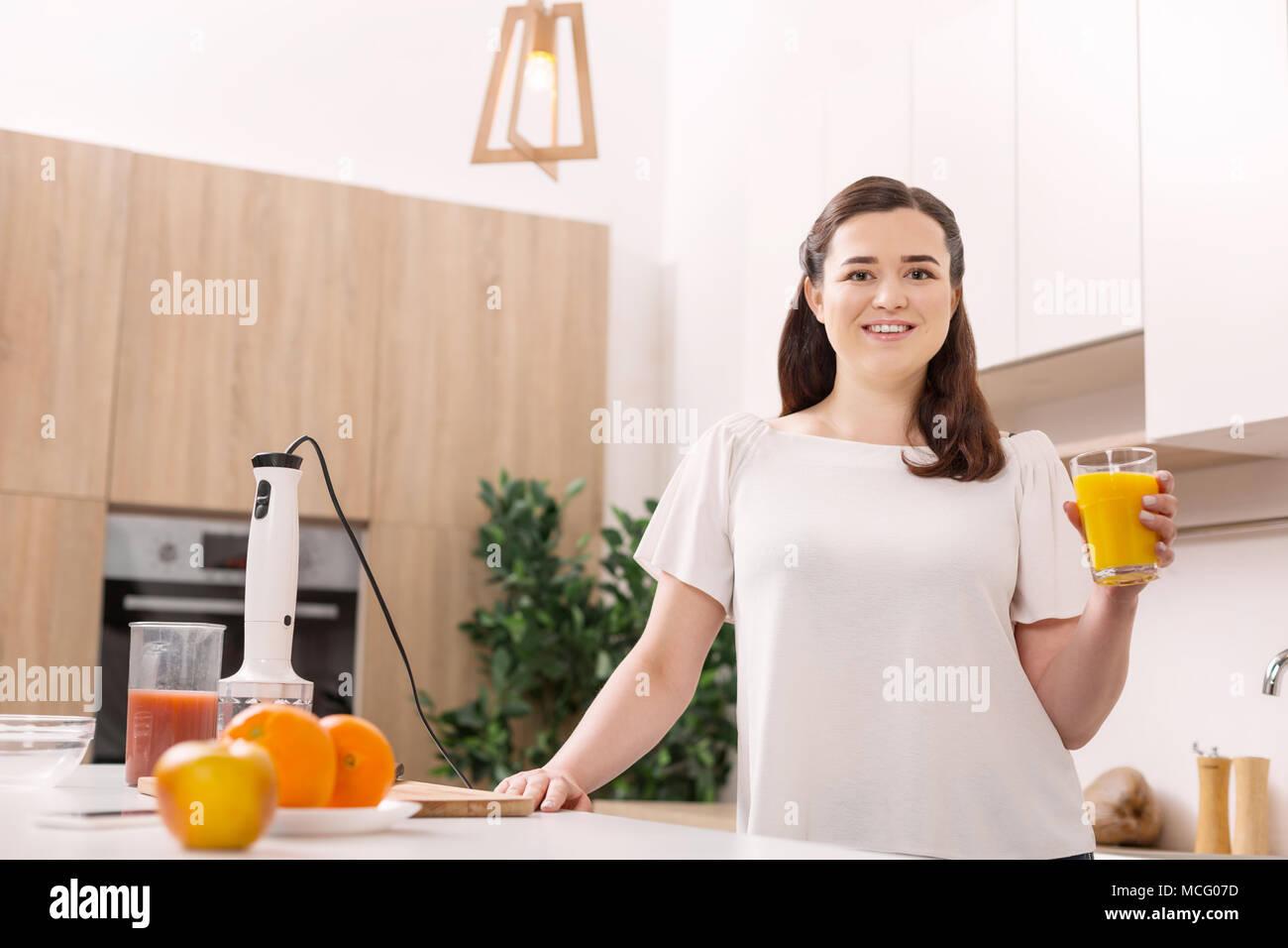 Attractive energetic woman having breakfast - Stock Image