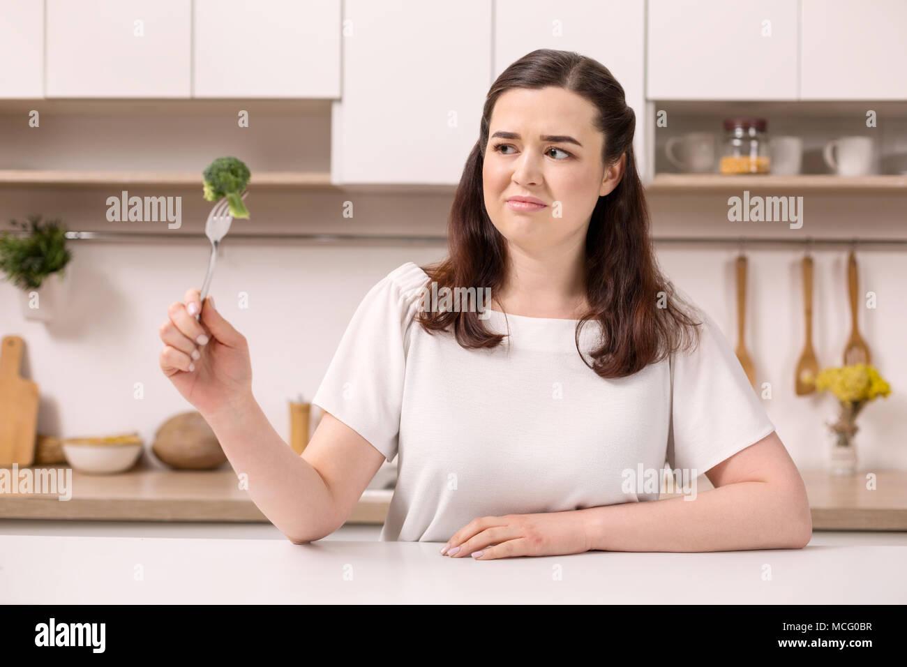 Upset sad woman controlling weight - Stock Image