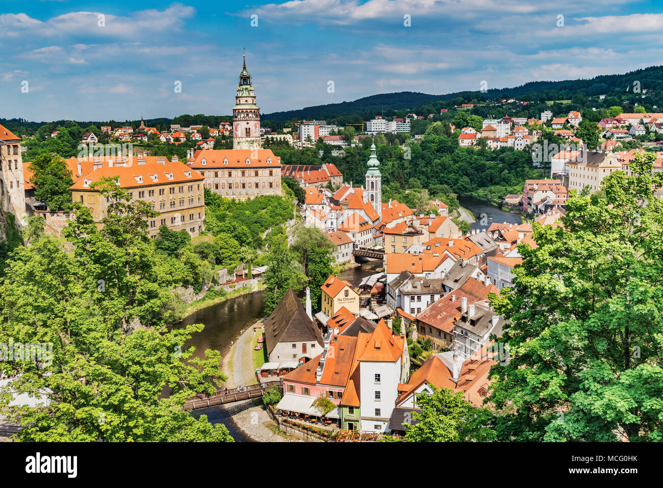 View of the old town and the Castle Cesky Krumlov, St. Jost church and the River Vltava in Bohemia, Jihocesky Kraj, Czech Republic, Europe - Stock Image